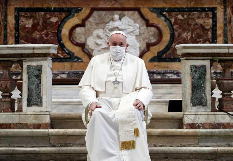 Pope wears mask for first time at public service