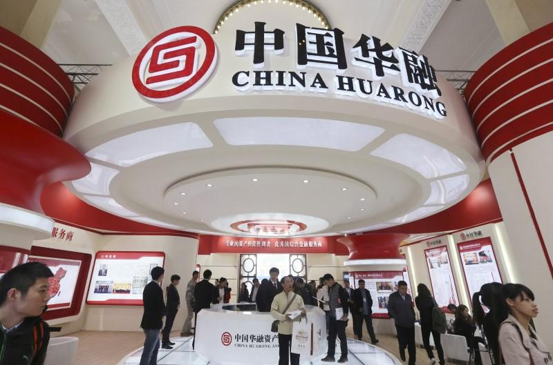 FILE PHOTO - Logos of China Huarong Asset Management Co are seen during a finance expo in Beijing