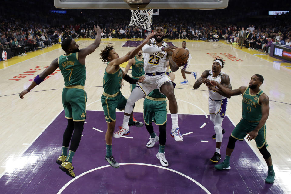 Los Angeles Lakers' LeBron James (23) drives to the basket against the Boston Celtics during the first half of an NBA basketball game Sunday, Feb. 23, 2020, in Los Angeles. (AP Photo/Marcio Jose Sanchez)