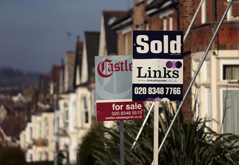 File photo dated 23/01/15 of For Sale and Sold signs outside houses in north London. The affordability gap between the most and least expensive places to live in England and Wales has increased to the widest point since records started more than 20 years ago, Office for National Statistics (ONS) figures show.