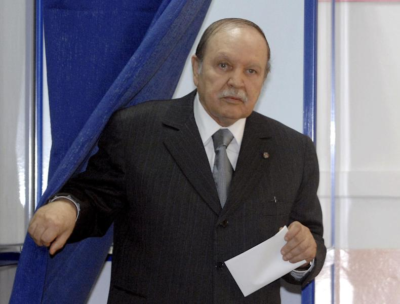 FILE - This May, 10, 2012 file photo shows Algerian President Abdelaziz Bouteflika exiting a parliamentary election voting booth in Algiers. Algeria's presidency says the country's ailing president has been in a Paris military hospital since Monday for a routine checkup and his condition is improving. Abdelaziz Bouteflika suffered a stroke in April and was hospitalized for four months in Paris' Val-de-Grace hospital. He has seemed visibly weak in rare television appearances since then. (AP Photo/Sidali Djarboub, File)