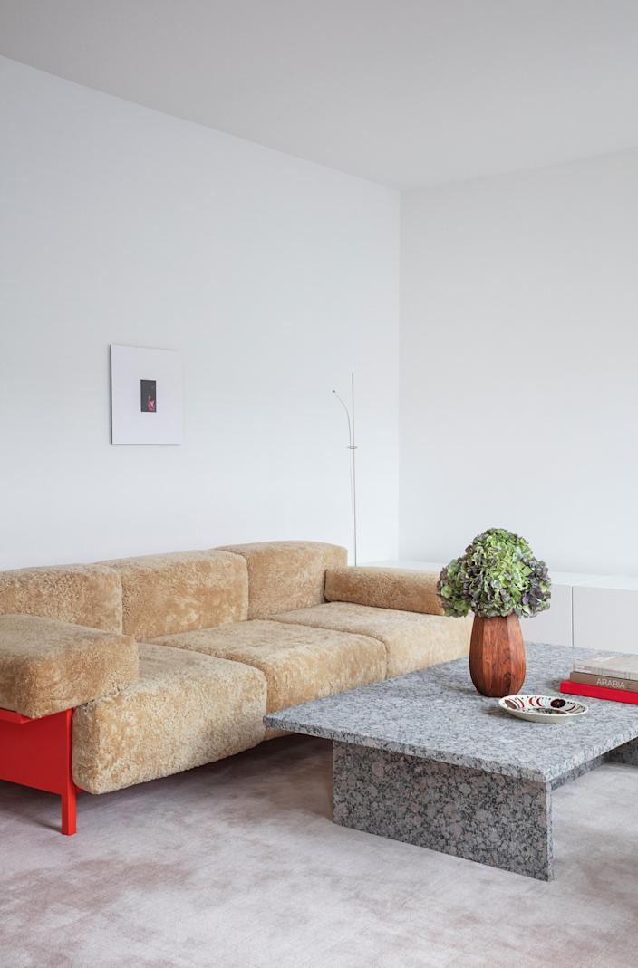 In the living room, the sheepskin-covered sofa is Thulstrup's Mooner design for Common Seating, the granite cocktail table was custom made, and the rug is by Massimo.