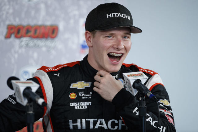 Josef Newgarden laughs during a news conference for Sunday's IndyCar Series auto race at Pocono Raceway, Saturday, Aug. 17, 2019, in Long Pond, Pa. (AP Photo/Matt Slocum)