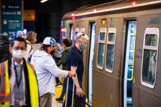 People ride the Skytrain on the first day of Translink's mandatory mask rule in Vancouver on Aug. 24, 2020.