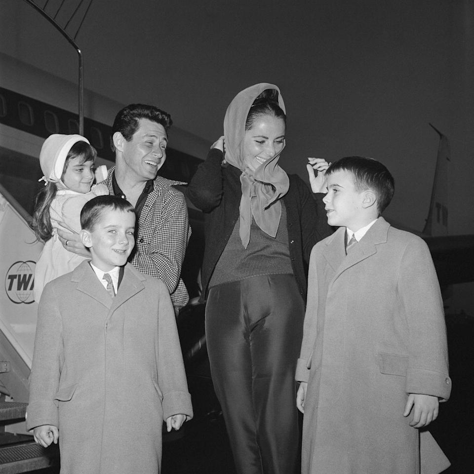 <p>Elizabeth meets her family at the airport after Eddie flew the children over to Rome where the actress was filming <em>Cleopatra</em>.  </p>