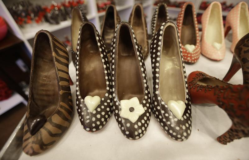 In this Feb. 7, 2013 photo, chocolate high heals made by master chocolatier Andrea Pedraza are lined up at her shop in the Oak Cliff section of Dallas. Florists and chocolate makers are working around the clock for the busy season - Valentine's Day. Pedraza's most well known creations are chocolate pumps done in the style of Christian Louboutin shoes. (AP Photo/LM Otero)