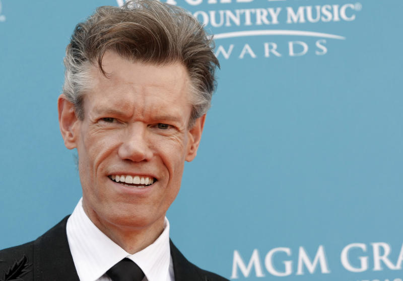 FILE - This April 18, 2010 file photo shows singer Randy Travis at the 45th Annual Academy of Country Music Awards in Las Vegas. Travis has been charged with driving while intoxicated in North Texas. The Grayson County Sheriff's Office says Travis was being jailed without bond Wednesday, Aug. 8, 2012, pending an appearance before a judge in Sherman, about 60 miles north of Dallas.   Sgt. Rickey Wheeler says Travis also faces a charge of retaliation or obstruction.   (AP Photo/Dan Steinberg, file)
