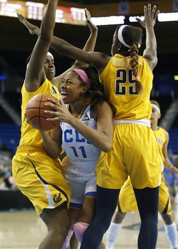 UCLA forward Atonye Nyingifa, center, is defended by California center Talia Caldwell, left, and forward Gennifer Brandon during the second half of an NCAA women's basketball game in Los Angeles, Friday, Feb. 15, 2013. California won 79-51. (AP Photo/Jae C. Hong)