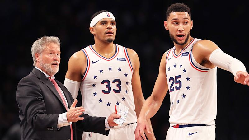 Pictured here, coach Brett Brown talks with Philadelphia players during an NBA game.