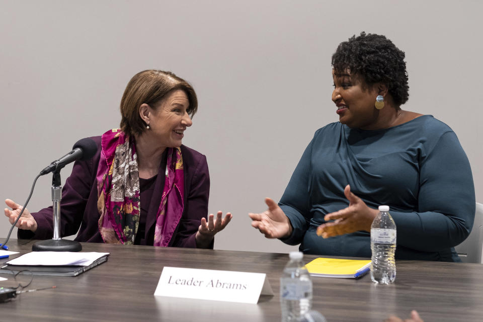 Sen. Amy Klobuchar, left, D-Minn., talks with former Georgia state Rep. Stacey Abrams during a meeting with residents about voting, in Smyrna, Ga., Sunday, July 18, 2021. (AP Photo/Ben Gray)
