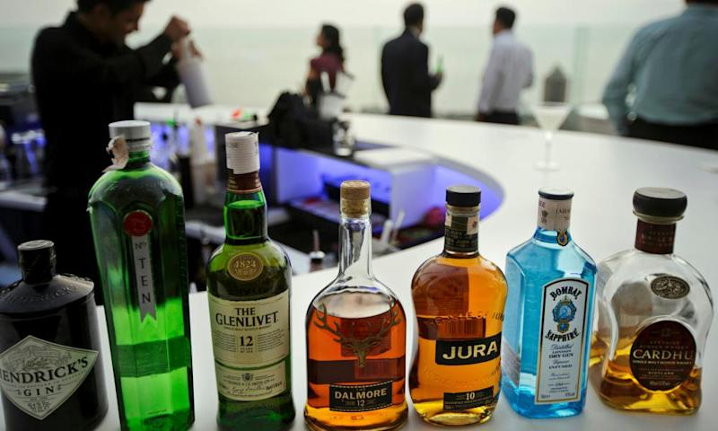 Bottles of scotch whisky among the drinks on offer at a bar in Mumbai, India