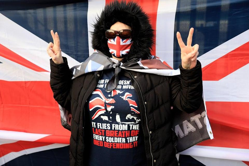 A supporter of Dennis Hutchings waits for his arrival at court (Peter Morrison/PA) (PA Wire)