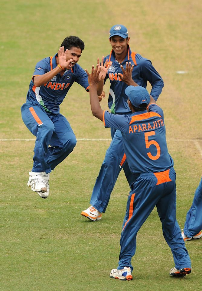 TOWNSVILLE, AUSTRALIA - AUGUST 26:(EDITORS NOTE: Image 150745160.jpg retransmitted with an alternate crop)  Ravi Kant Singh (L) of India celebrates a wicket with team mates during the 2012 ICC U19 Cricket World Cup Final between Australia and India at Tony Ireland Stadium on August 26, 2012 in Townsville, Australia.  (Photo by Matt Roberts/Getty Images)