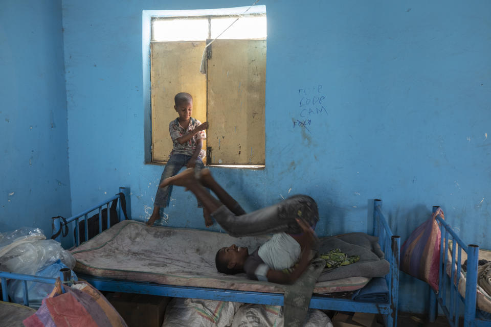 Tigrayan 5-year-old refugee Micheale Gebremariam, left, plays with a friend inside his family's shelter in Hamdayet, eastern Sudan, near the border with Ethiopia, on March 21, 2021. (AP Photo/Nariman El-Mofty)