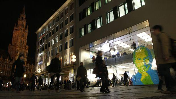 The face of Apple co-founder and former CEO Steve Jobs is created with adhesive notes on the window of an Apple Store in Munich