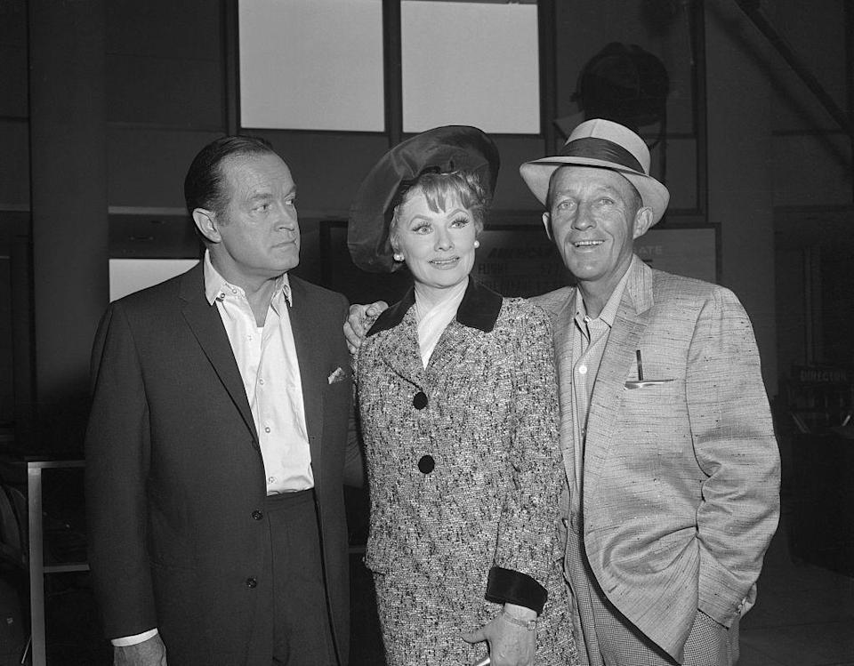 <p>Bob Hope, Lucille Ball, and Bing Crosby pose together at Warner Bros. Studios in 1962.</p>
