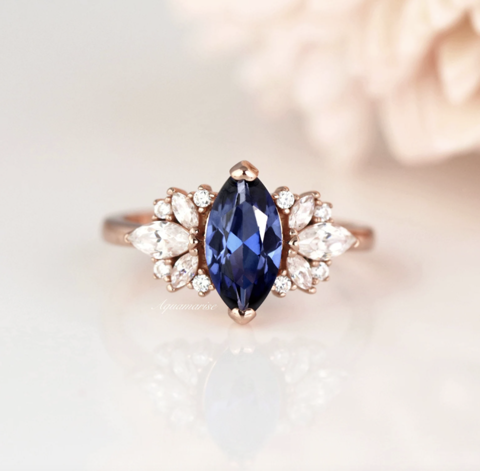 Ceylon Marquise Sapphire Ring with clusters of diamonds on either side