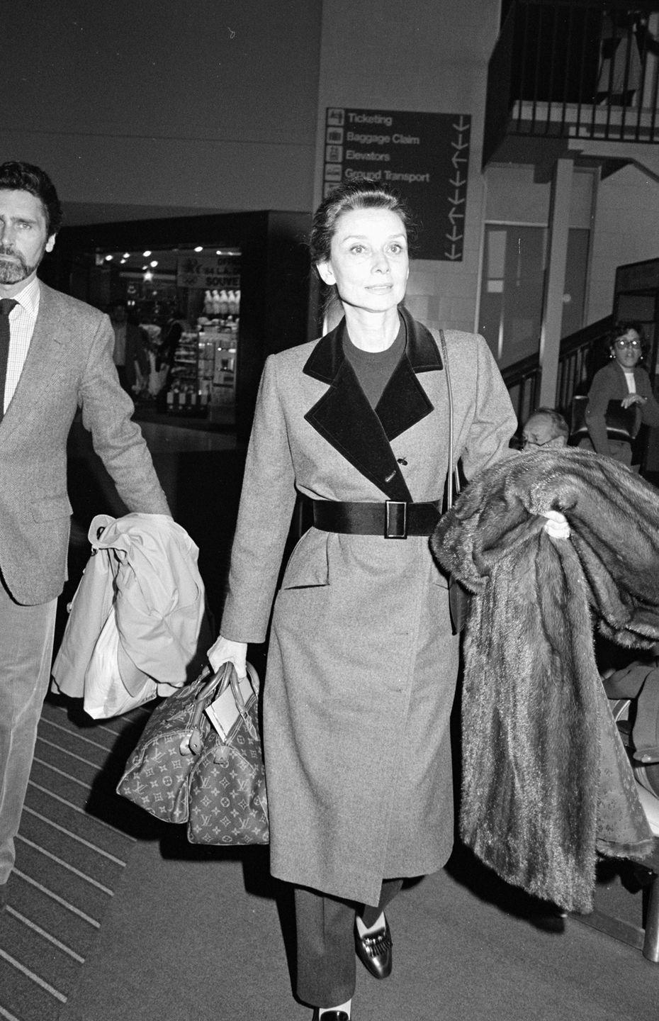 <p>A Louis Vuitton bag is often the go-to airport carry-on for celebrities, but it was particularly chic when Audrey Hepburn did it in '84. </p>