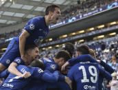 Chelsea's Kai Havertz celebrates with teammates after scoring his side's opening goal during the Champions League final soccer match between Manchester City and Chelsea at the Dragao Stadium in Porto, Portugal, Saturday, May 29, 2021. (Jose Coelho/Pool via AP)