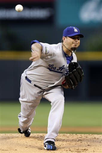 Los Angeles Dodgers starting pitcher Josh Beckett delivers during the first inning of a baseball game against the Colorado Rockies in Denver, Monday, Aug. 27, 2012. (AP Photo/Joe Mahoney)