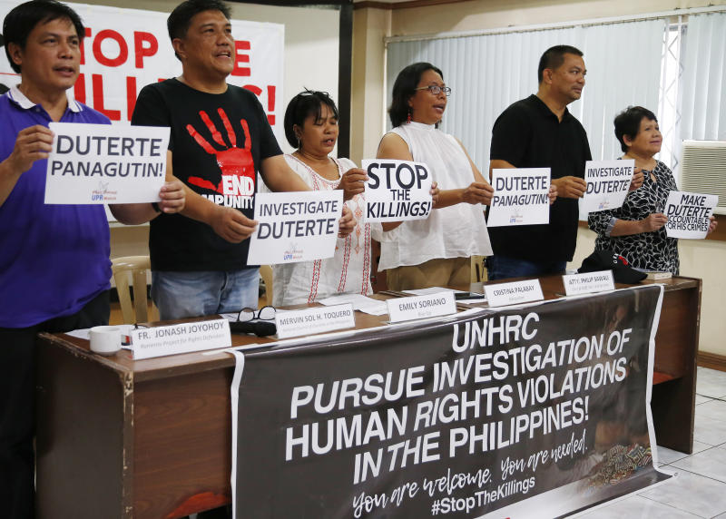 Human rights advocates display placards during a news conference following United Nations Human Rights Council's resolution in Geneva, Friday, July 12, 2019 in suburban Quezon city, northeast of Manila, Philippines. The U.N.'s top human rights body has narrowly passed a resolution that includes calls for greater scrutiny in the Philippines. (AP Photo/Bullit Marquez)