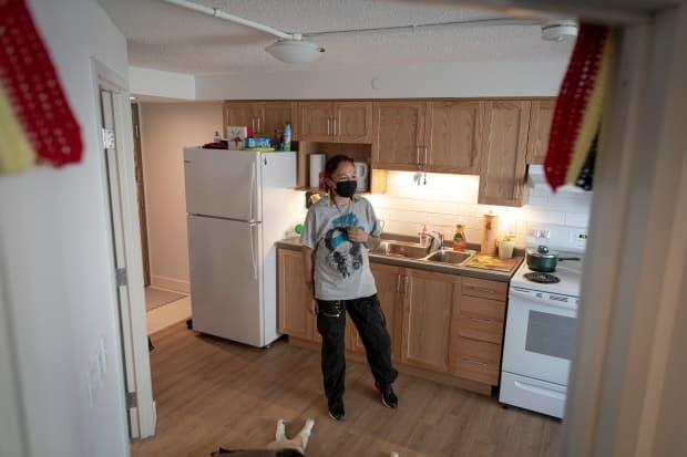 Nikki Renaud is pictured in her new apartment in Toronto on April 26. (Evan Mitsui/CBC - image credit)
