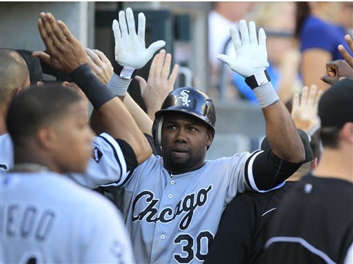 Chicago White Sox's Alejandro De Aza (30) is greeted in the dugout after hitting a two-run home run during the third inning of a baseball game against the Detroit Tigers in Detroit, Friday, July 20, 2012. (AP Photo/Carlos Osorio)