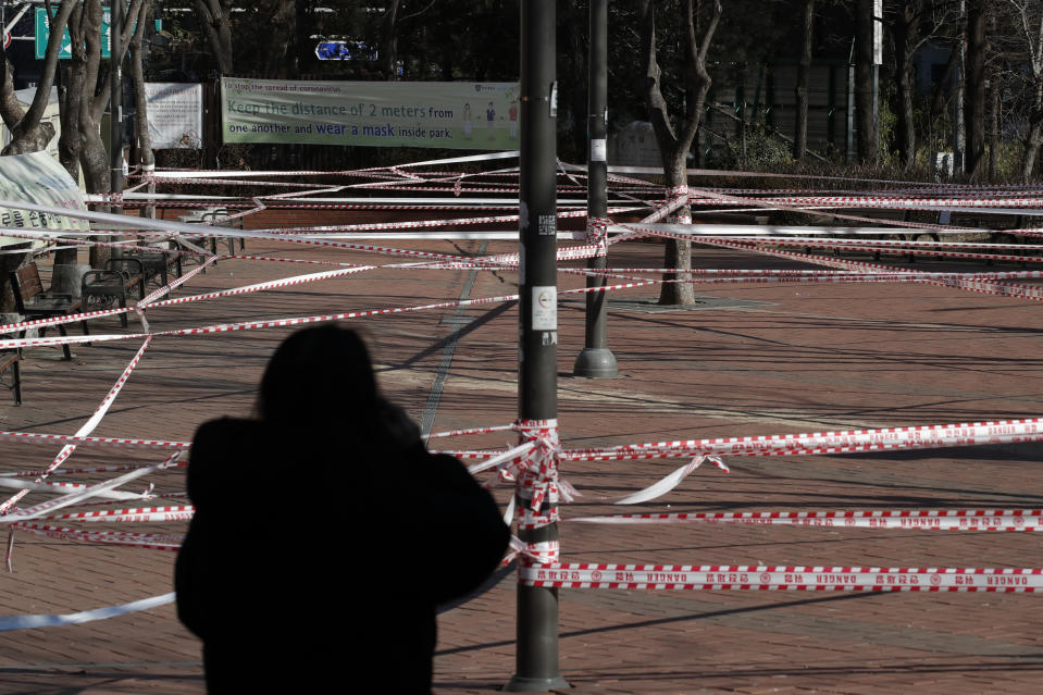 A park is taped off for the social distancing measures and a precaution against the coronavirus in Seoul, South Korea on Dec. 16, 2020. South Korea had seemed to be winning the fight against the coronavirus: Quickly ramping up its testing, contact-tracing and quarantine efforts paid off when it weathered an early outbreak without the economic pain of a lockdown. But a deadly resurgence has reached new heights during Christmas week, prompting soul-searching on how the nation sleepwalked into a crisis. (AP Photo/Lee Jin-man)