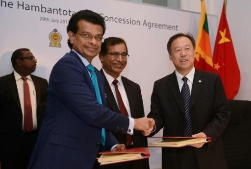 <p>Sri Lanka hands over debt-laden port to Chinese owner</p>