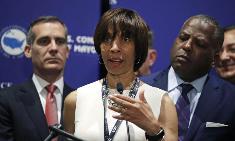 FILE - In this June 8, 2018 file photo, Baltimore Mayor Catherine Pugh addresses a gathering during the annual meeting of the U.S. Conference of Mayors in Boston. Baltimore's mayor resigned under pressure Thursday. May 2, 2019 amid a flurry of investigations into whether she arranged bulk sales of her self-published children's books to disguise hundreds of thousands of dollars in kickbacks.(AP Photo/Charles Krupa, File)