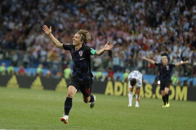 Croatia's Luka Modric celebrates with teammates after scoring his side's second goal during the group D match between Argentina and Croatia at the 2018 soccer World Cup in Nizhny Novgorod Stadium in Nizhny Novgorod, Russia, Thursday, June 21, 2018. Modric scored once in Croatia's 3-0 victory. (AP Photo/Ricardo Mazalan)