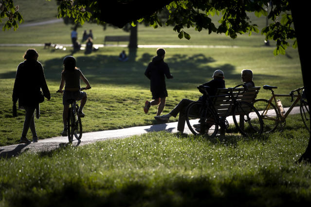 People relax and exercise in Primrose Hill park in central London, as the UK continues in lockdown to help curb the spread of the coronavirus. (PA)