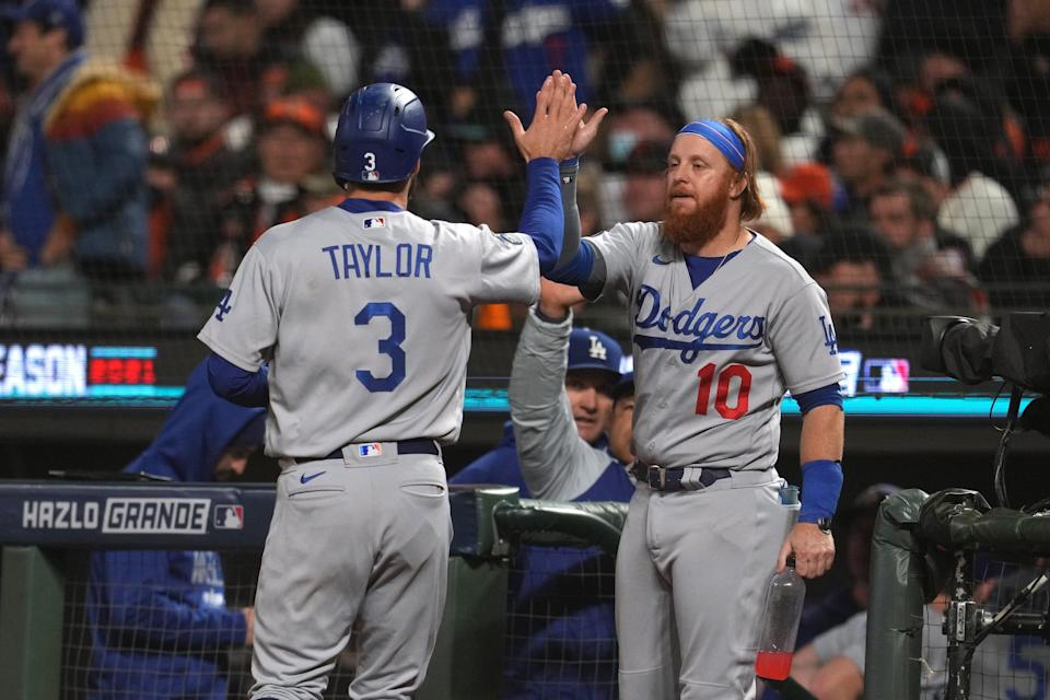 Chris Taylor celebrates with Justin Turner after scoring a run in Game 2.