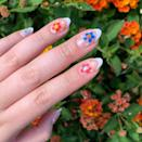 """At this point, it's undeniable that the <a href=""""https://www.glamour.com/story/french-manicure-ideas?mbid=synd_yahoo_rss"""" rel=""""nofollow noopener"""" target=""""_blank"""" data-ylk=""""slk:French manicure"""" class=""""link rapid-noclick-resp"""">French manicure</a> is this year's biggest trend. Spice things up a bit with colorful flowers."""