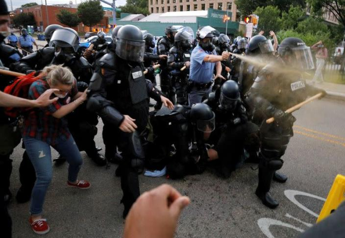 FILE PHOTO: A police officer discharges pepper spray during nationwide unrest following the death in Minneapolis police custody of George Floyd, in Raleigh