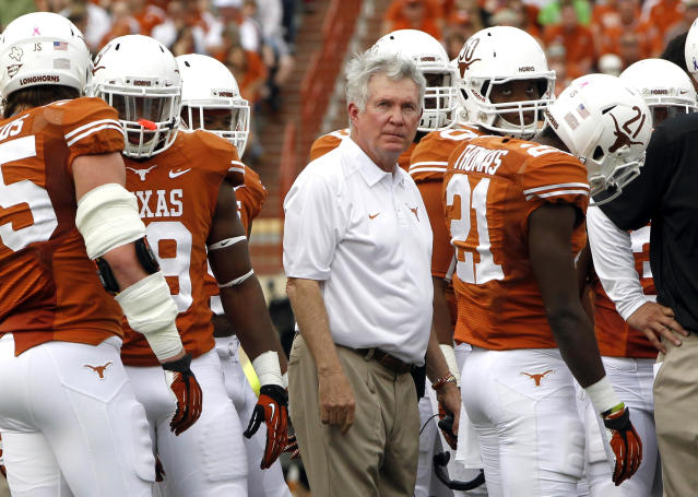 FILE - In this Nov. 16, 2013, file photo, Texas coach Mack Brown watches a video reply with his team during the first quarter of an NCAA college football game against Oklahoma State in Austin, Texas. Brown is facing an interesting weekend: He's trying to win a league championship at No. 9 Baylor on Saturday while fighting off speculation he could be fired. (AP Photo/Michael Thomas, File)