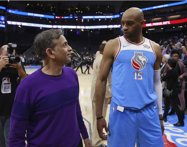 Sacramento Kings owner Vivek Ranadive talks to Kings forward Vince Carter after a game on March 22, 2018, in Sacramento, Calif. (AP Photo/Rich Pedroncelli)