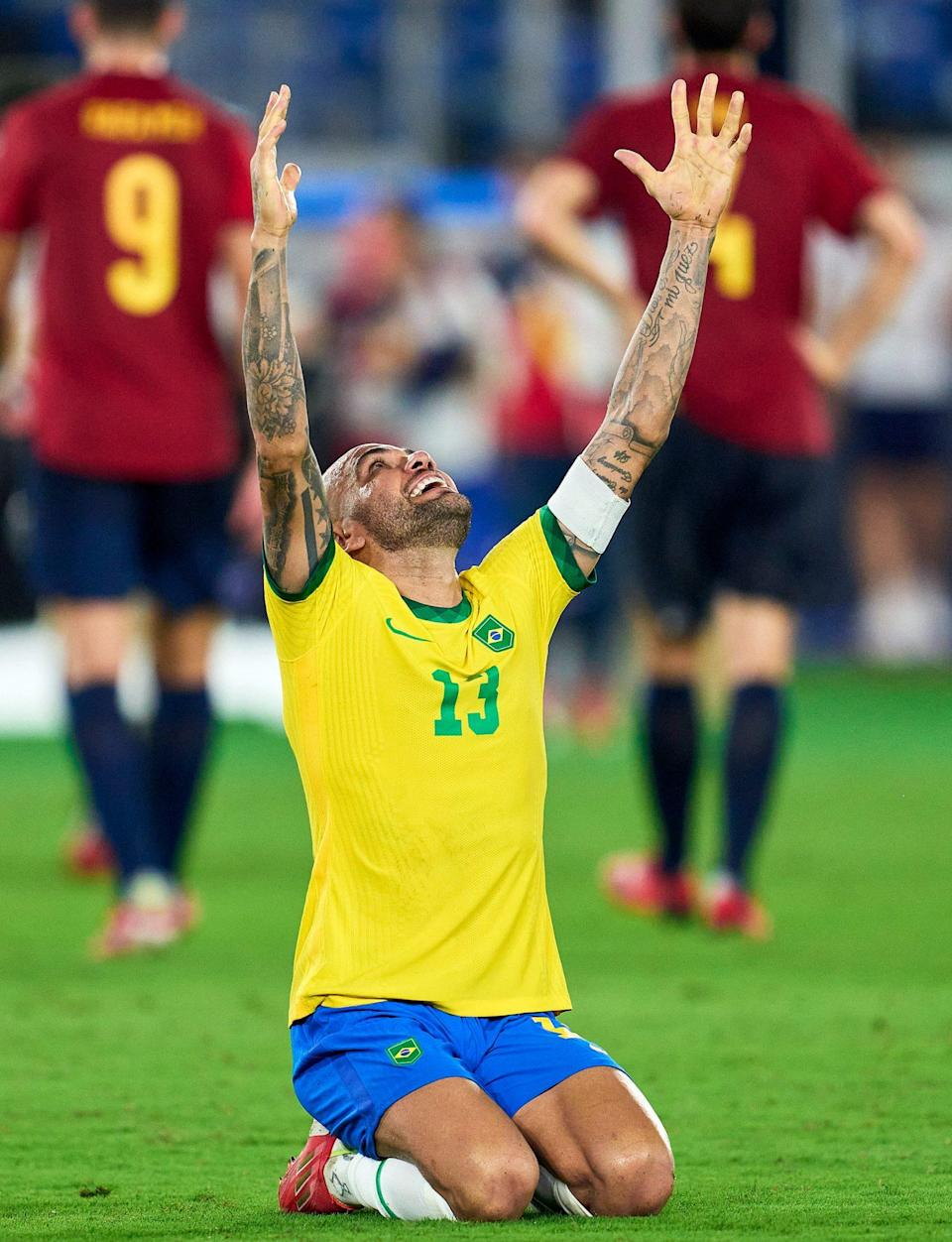<p>Dani Alves of Team Brazil celebrates victory after the Men's Gold Medal Soccer Match between Team Brazil and Team Spain. </p>