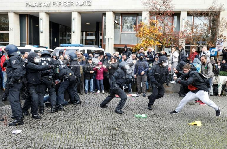 Police in Berlin fired water cannon to disperse thousands of unmasked protesters