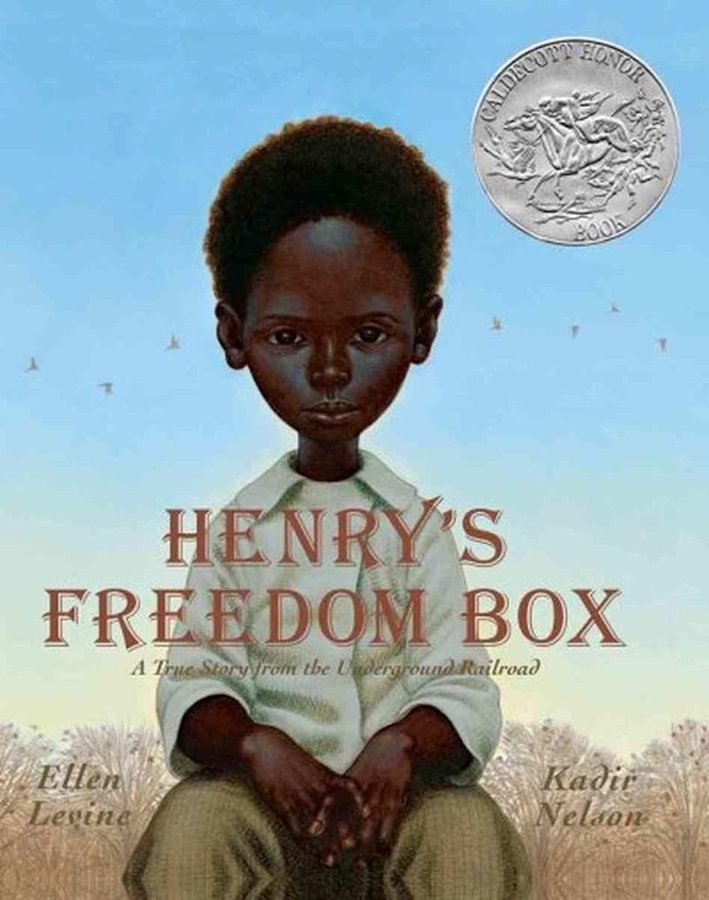 """A retelling of the true story of Henry """"Box"""" Brown, written by Ellen Levine and illustrated by Kadir Nelson, this gorgeous picture book shows Brown's heartbreaking separation from his wife and children, who are sold to new owners, and his determination to escape by any means. His ultimate, successful plan: mailing himself to freedom in a box."""