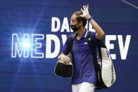 Daniil Medvedev, of Russia, walks onto the court to play against Novak Djokovic, of Serbia, during the men's singles final of the US Open tennis championships, Sunday, Sept. 12, 2021, in New York. (AP Photo/John Minchillo)