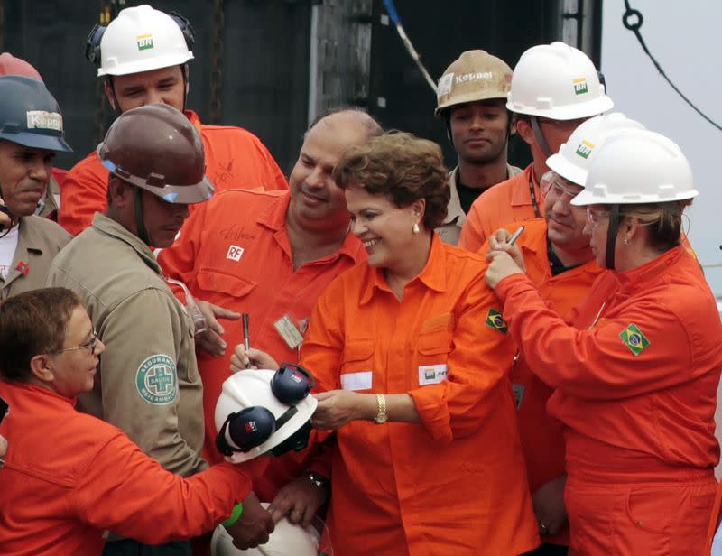 File photo of Brazil's President Rousseff signing autographs during Petrobras' opening ceremony of the P-56 oil rig at Angra dos Reis