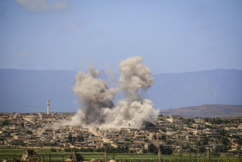 FILE - In this May 3, 2019 file photo, provided by the Syrian Civil Defense White Helmets, which has been authenticated based on its contents and other AP reporting, shows smoke rising after Syrian government and Russian airstrikes that hit the town of al-Habeet, southern Idlib, Syria. Russia said Sunday, May 19, 2019, that Syrian government forces have unilaterally ceased fire in the northern Idlib province, the last major rebel stronghold. Fighting erupted in Idlib last month, effectively shattering a cease-fire negotiated by Russia and Turkey that had been in place since September. (Syrian Civil Defense White Helmets via AP, File)