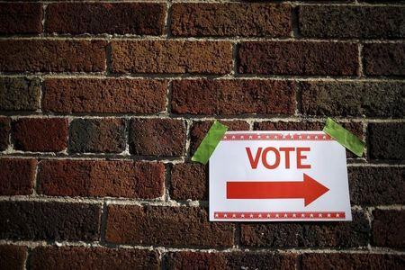 A sign is taped to a brick wall outside a polling station for the Wisconsin presidential primary election in Milwaukee