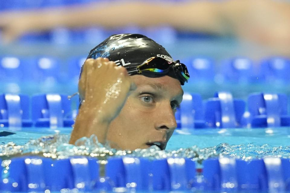 Caeleb Dressel reacts after winning his heat in the men's 100 freestyle during wave 2 of the U.S. Olympic Swim Trials on Wednesday, June 16, 2021, in Omaha, Neb.(AP Photo/Charlie Neibergall)