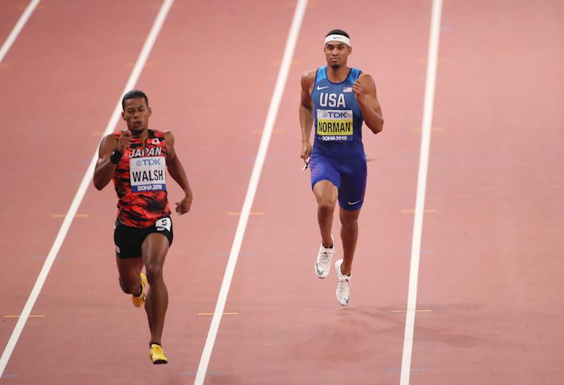 American sprinter Michael Norman, right, jogged to the finish in his 400 meter semifinal heat on Wednesday. He will not be in the event final. (Getty Images)