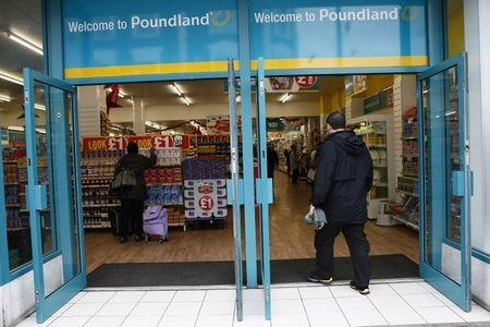 A man enters a Poundland store in London, Britain