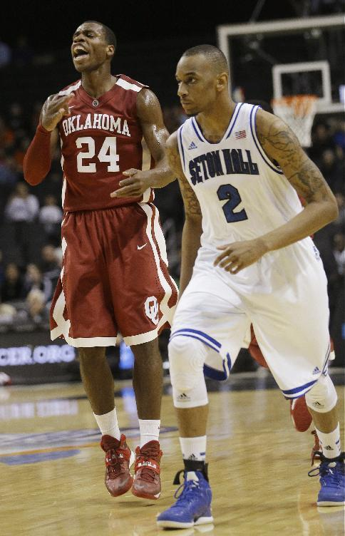 Oklahoma Buddy Hield (24) celebrates after hitting a three-point basket against Seton Hall during the first half of a Coaches vs. Cancer NCAA college basketball game Friday, Nov. 22, 2013, in New York. Oklahoma won the game 86-85. (AP Photo/Frank Franklin II)