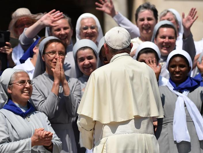 Pope Francis greets a group of nuns at St Peter's Square in the Vatican, on June 30, 2016 (AFP Photo/Gabriel Bouys )