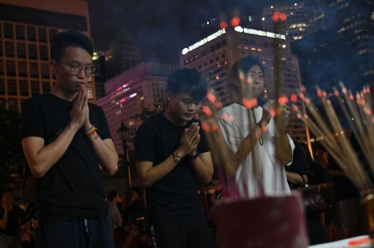 Prayers during a vigil for young people who have killed themselves in recent weeks in Hong Kong (AFP Photo/HECTOR RETAMAL)